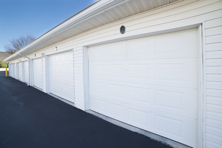 Row of garage doors at parking area for apartment homes Stock Photo