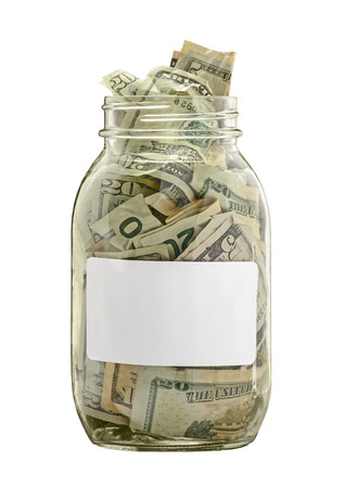 Money Jar Filled With Cash With White Label Isolated On White