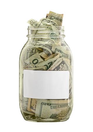 ホワイト ラベル白で隔離と現金で満たされたお金瓶