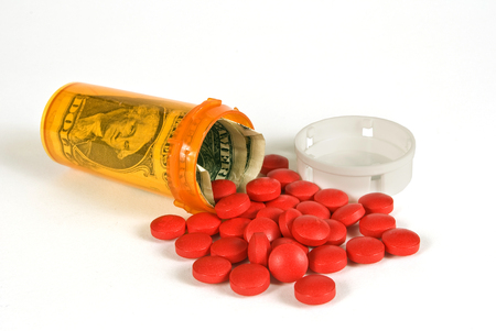 expense: Medical Expense Concept Pill Bottle With Money Inside