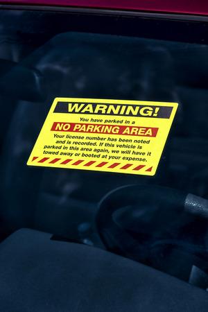 affixed: WARNING Parking Sticker on Windshield
