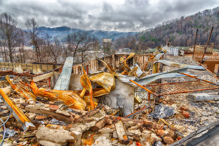 GATLINBURG, TN/USA - December 14, 2016: A motel complex lies in ruins after a major forest fire roared through Gatlinburg and a large section of the Smoky Mountains in late December 2016.
