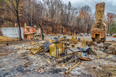 gutted: GATLINBURG, TENNESSEEUSA - DECEMBER 14, 2016: A tourist cabin that has been burned to the ground  by a forest fire in Gatlinburg in late 2016.