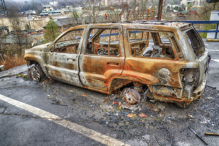 GATLINBURG, TENNESSEEUSA - DECEMBER 14, 2016: A burned-out car waits for clean-up crews in the aftermath of a massive forest fire that destroyed part of Gatlinburg, TN in late 2016.