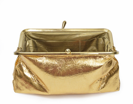 Horizontal shot of an open empty gold metallic coin purse with the focus on the back closure on a white background. Imagens
