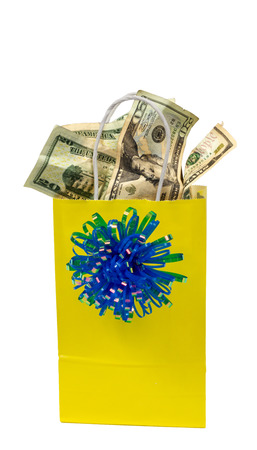 Vertical shot of a yellow gift bag with blue bow that is full of money.  Isolated on White.  Copy Space. Stok Fotoğraf