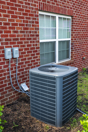 Vertical shot of an air conditioning unit for an apartment home. Banco de Imagens