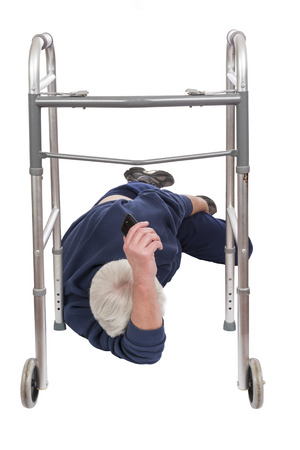 Vertical shot of an elderly man who has fallen down while using his walker isolated on white.  He is laying on his side.  His face cannot be seen.