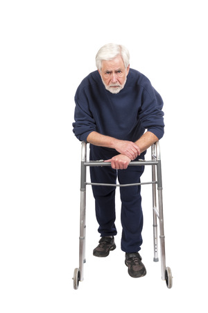 Horizontal shot of a weak and discouraged old man leaning on his walker isolated on white with copy space. Stock Photo