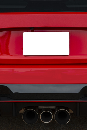 Vertical shot of a blank white license plate on the back of a red car. Stockfoto - 120551115