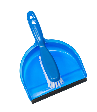 Vertical shot of a blue dustpan with a blue brush with white bristles lying on top of it handle to handle. Isolated on white with copy space.