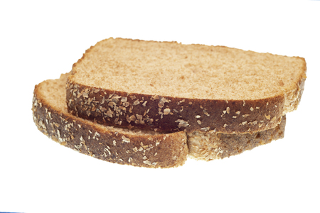 Horizontal shot of two stacked slices of whole-wheat bread isolated on white. Stok Fotoğraf