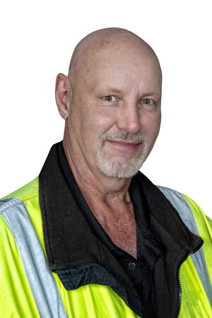 Vertical shot from the chest up of a friendly mature male worker in reflective clothing.  Isolated on white.