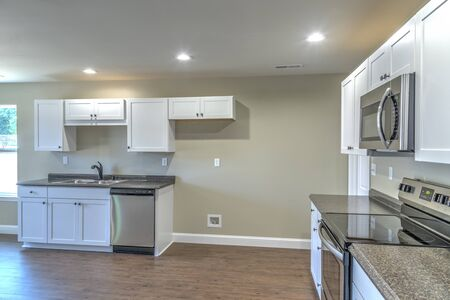 Horizontal shot of the kitchen area of a new small tract home.