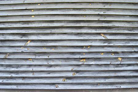 Horizontal close-up shot of old narrow wood paneling. Banque d'images