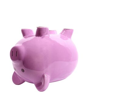 Horizontal side view shot of a pink piggy bank on its back on the left side of the picture. White background with lots of copy space.