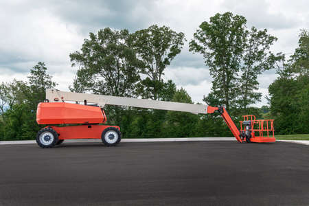 Horizontal side shot of a generic unbranded boom lift. Stock Photo
