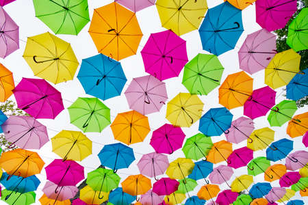 Horizontal overhead shot of a group of colorful umbrellas.