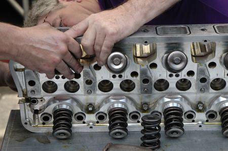 lubrication: Skilled race car engine maintenance.