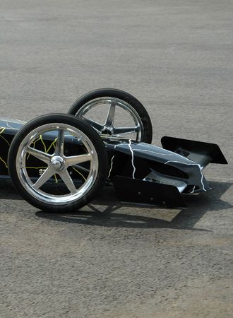 Front wheels and aerodynamics of a drag car. Stock Photo - 565195
