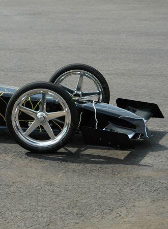 Front wheels and aerodynamics of a drag car. Stock Photo - 565195