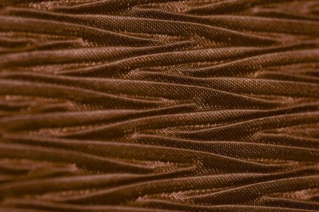 Macro of chocolate color textured fabric. photo
