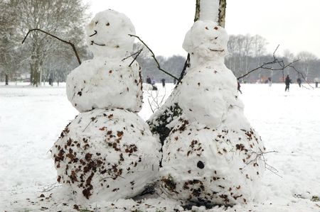 Snowmen in park with people playing. Stock Photo - 770304