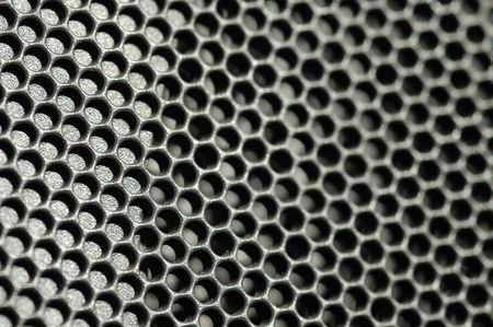 honeycombed: macro of sparkly metallic honeycomb panel Stock Photo