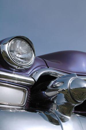 round rods: purple 1950s classic car against blue sky