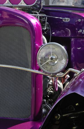 purple hot rod with engine exposed