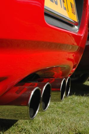 sportscar: close-up of multiple sports car exhausts Stock Photo