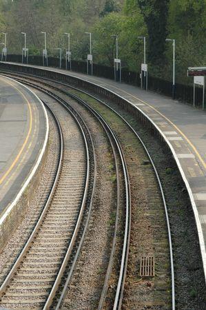 deserted railroad platform on a bend Stock Photo