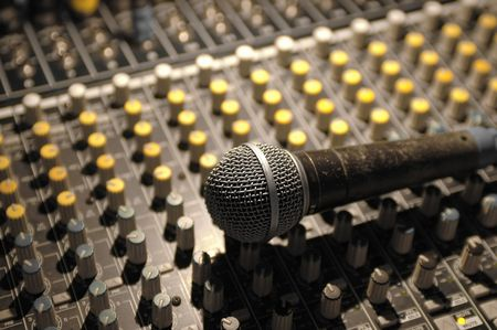 microphone and soundboard under theater lighting