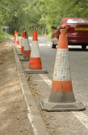 kerb: traffic safety cones on british road - third view of three