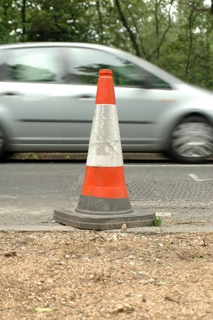 traffic safety cone on british road - first view of three