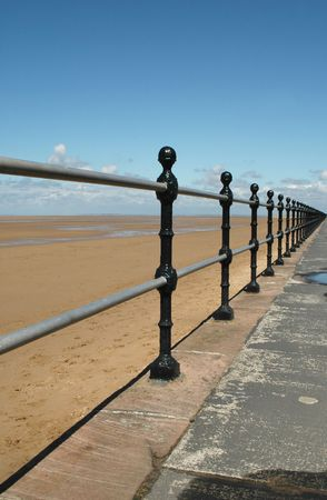 vanishing: beach railings to vanishing point Stock Photo