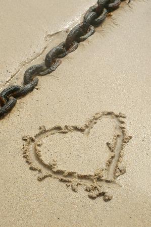 honeymoons: valentines concept in sand Stock Photo