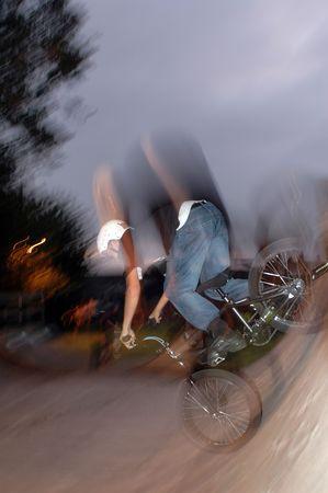 teenager in stunt bike action blur Stock Photo - 1922475