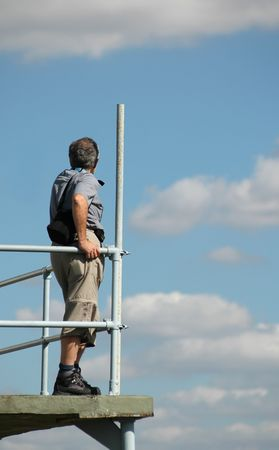 airfield: man viewing clouds from airfield observation platform