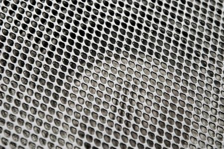 vibrations: large metal audio speaker mesh abstract Stock Photo
