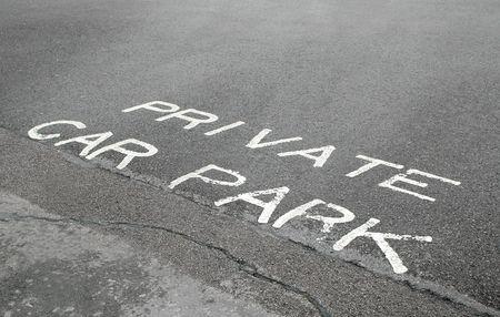 private car park sign on asphalt photo