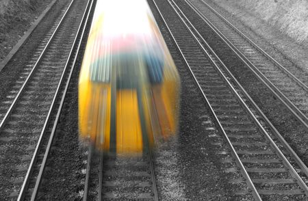 speeding train blur on black and white rail tracks Stock Photo - 2421434