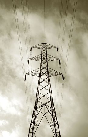 over voltage: grunge clouds over high voltage cables Stock Photo