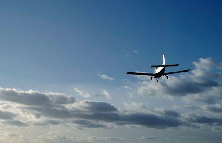 runways: light aircraft on sunset landing approach