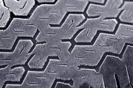 winter frost on worn car tire Stock Photo - 2585675
