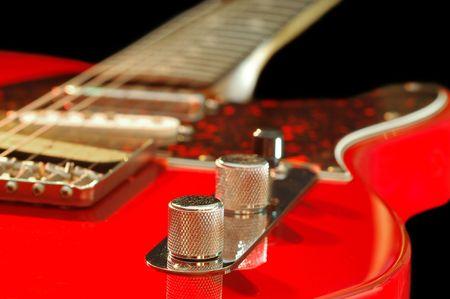 pickups: vintage red electric guitar close-up