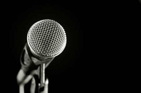vocal microphone isolated on black photo