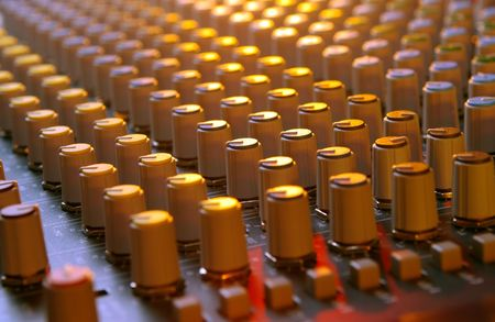 soundboard: soundboard mixer under multi-colored lights Stock Photo