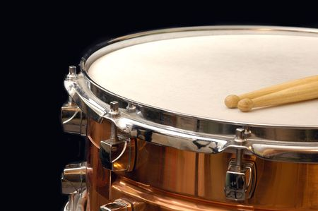 snare: copper snare drum and sticks on black Stock Photo