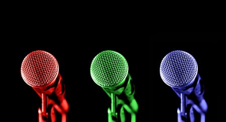 primary colored microphones on black Stock Photo - 2658589